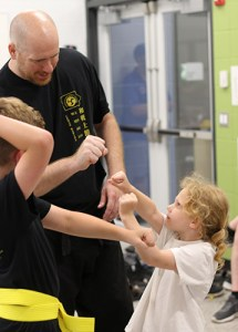 Adam Frey teaches an Open Hand karate class Cedar Rapids