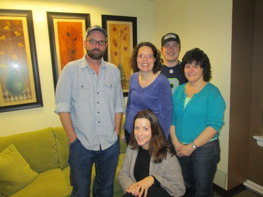 Actor/Producer/Teacher Tony Doupe with Director of Finance & Operations Julie Daman, Production Services Coordinator Krys Karns, Accounting Assistant Ken Hagen, and Administrative Assistant Cris Walters.