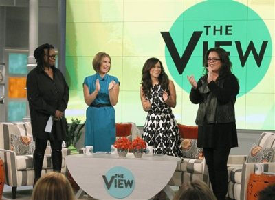"""In this image released by ABC, co-hosts, from left, Whoopi Goldberg, Nicolle Wallace, Rosie Perez and Rosie O'Donnell appear on the set of the daytime talk show """"The View,"""" on Monday, Sept. 15, 2014 in New York. (AP Photo/ABC, Lou Rocco)"""