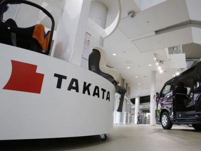 A Takata safety-equipment display at a Toyota showroom in Tokyo. A fifth death has been reported involving Hondas with Takata bags. Millions of vehicles have been recalled worldwide because of the Takata defect. (Shizuo Kambayashi/AP)