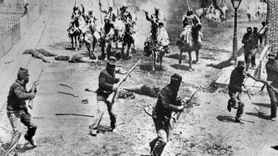 "This 1914 file photo shows a scene from D.W. Griffith's ""Birth of a Nation"" movie depicting Ku Klux Klan members riding horses against soldiers, filmed in the Hollywood section of Los Angeles. Based on Thomas Dixon's novel, ""The Clansman,"" it was set in the American Civil War. Earlier films often lasted less than an hour and were completed within days. ""Birth of a Nation"" took six months to produce, had a running time of 195 minutes and employed hundreds of actors. In 1992, the Library of Congress added Griffith's work to the National Film Registry, calling it a ""controversial, explicitly racist, but landmark American film masterpiece."" (AP Photo)"