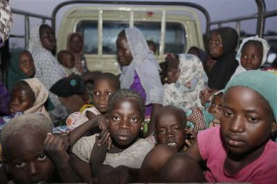 In this Saturday May 2, 2015 file photo, women and children rescued by Nigeria soldiers from Islamist extremists at Sambisa forest arrive at a camp for the displaced people in Yola, Nigeria. All 275 women, girls and children rescued from Boko Haram and taken to the safety of a northeast Nigerian refugee camp have been taken into military custody amid suspicions that some are aiding the Islamic extremists, a camp official and a Nigerian military intelligence officer said Wednesday May 20, 2015. (AP Photo/Sunday Alamba File)