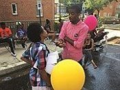 Markus Batchelor, candidate for the Ward 8 State Board of Education seat, chats with a constituent. (Courtesy photo)