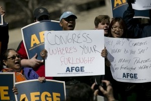 Federal employees protest the sequester outside the Department of Labor on March 20. (Andrew Harrer/Bloomberg).