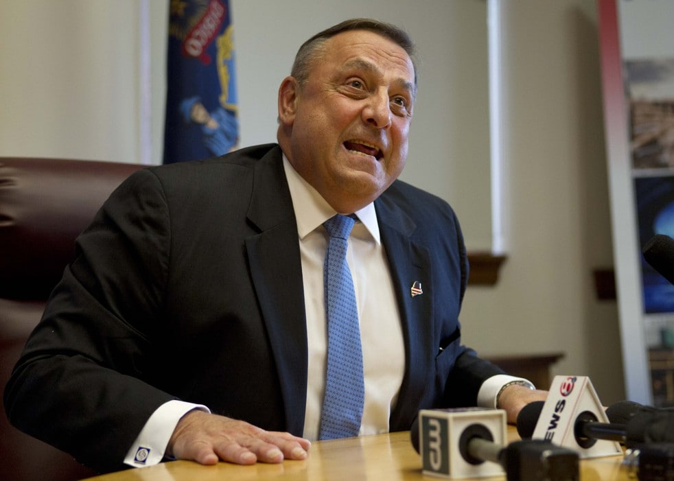 FILE - In this June 26, 2013 file photo, Gov. Paul LePage speaks to reporters shortly after the Maine House and Senate both voted to override his veto of the state budget, at the State House in Augusta, Maine. The Republican governor's clash with Democratic lawmakers over whether to expand Medicaid under the Affordable Care Act ended with the governor's veto - and a vow by Democrats to try again. The story, one of several quarrels between the GOP governor and Democratic-controlled Legislature, was voted the top story of 2013 in Maine in a survey by The Associated Press and its member news organizations in Maine. (AP Photo/Robert F. Bukaty, File)