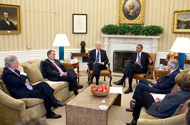 President Obama, Vice President Biden and congressional leaders working out the fiscal cliff deal, which would delay the sequester for two months. (Pete Souza/White House)