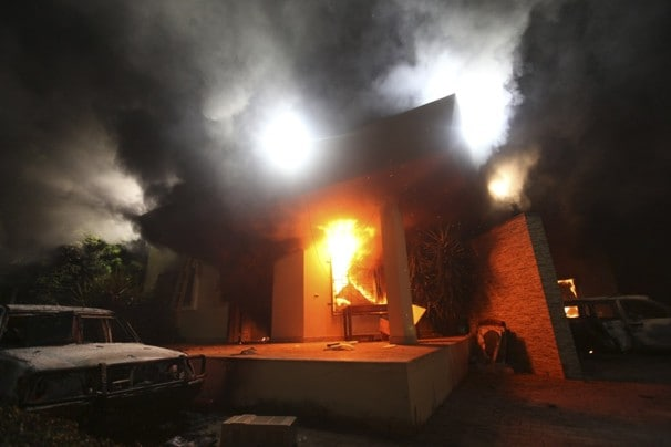 "The U.S. ""diplomatic post"" in Benghazi in flames after the attack of Sept. 11, 2012. (Esam Omran Al-Fetori/Reuters)"