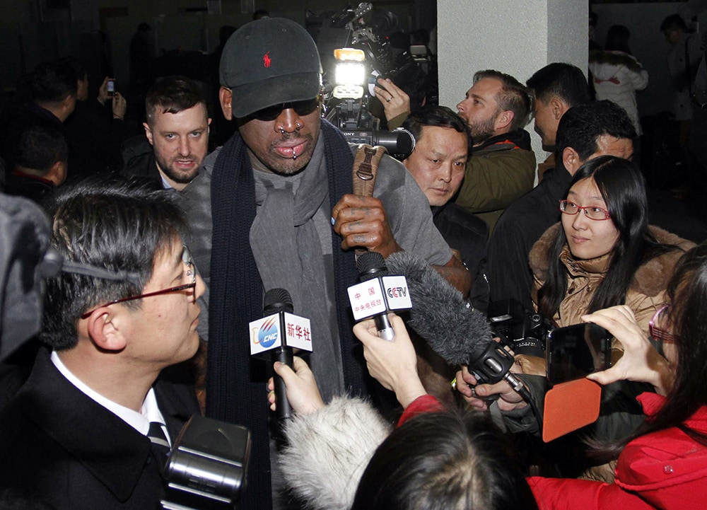 Dennis Rodman is surrounded by journalists in Pyongyang, North Korea, during his February 2013 trip. (Kim Kwang Hyon/AP)