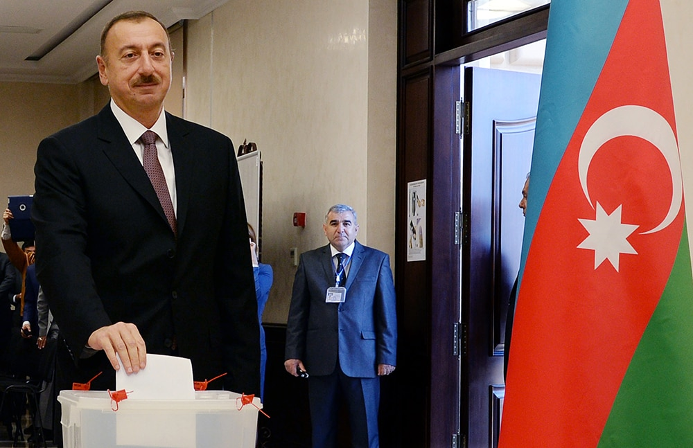 Azerbaijani President Ilham Aliyev votes in Baku on Wednesday. (AFP/Getty Images)