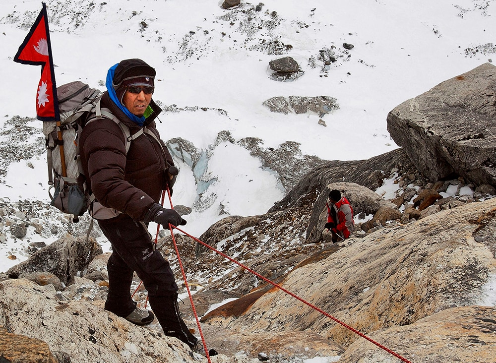 Apa Sherpa climbs the Himalayan mountains on the way to the Tsho Rolpa Glacier Lake in Nepal. (The Great Himalayan Trail via AP)