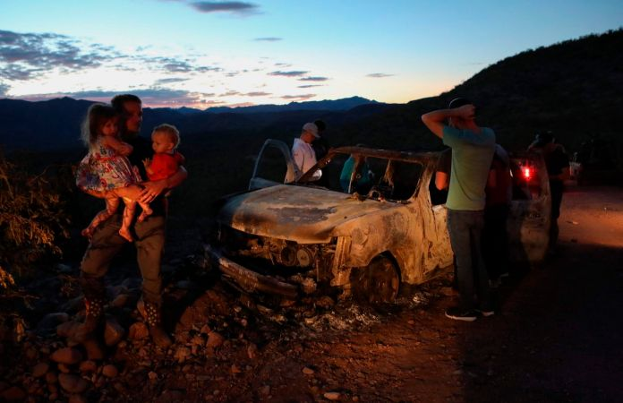 Members of the LeBaron family look at one of the vehicles burned in the attack Monday. (Herika Martinez/AFP/Getty Images)