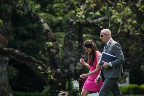 Then-White House aide Hope Hicks walks with Keith Schiller, President Trump's longtime security guard. (Jabin Botsford/The Washington Post)