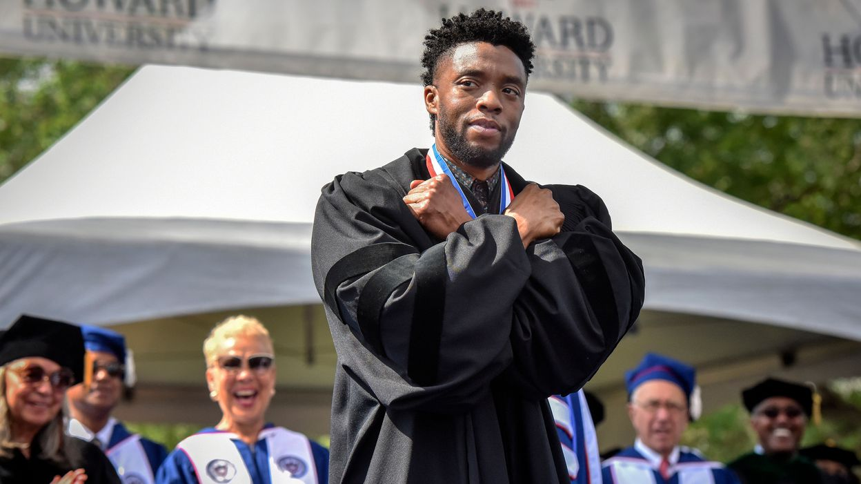 Chadwick Boseman gives a Wakanda salute at Howard University's 2018 commencement in Washington. (Bill O'Leary/The Post)