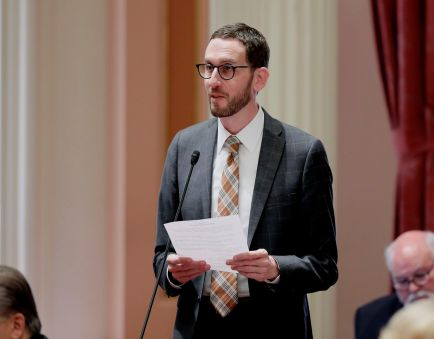 State Sen. Scott Wiener (D-San Francisco) addresses the California Senate, which passed the toughest net neutrality law in the country. Wiener sponsored the bill. (Rich Pedroncelli/AP)