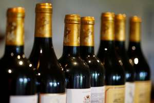 Bottles of French red wine are displayed at the Chateau du Pavillon in Sainte-Croix-du-Mont, France, on July 29, 2019. (Regis Duvignau/Reuters)