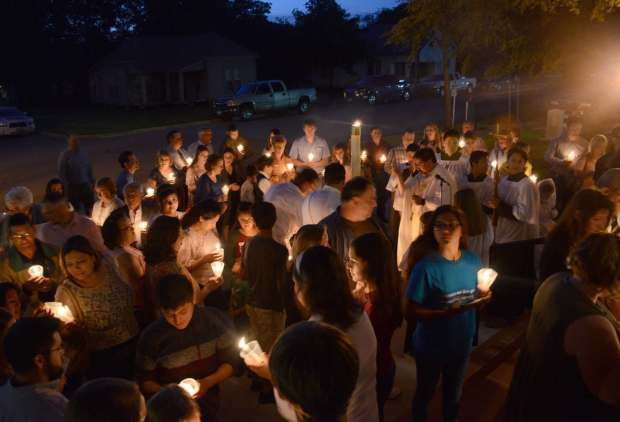 People gather in West, Tex., in memory of those who lost their lives in an explosion at the West Fertilizer Co. plant in 2013. (Dan Zak// The Washington Post)