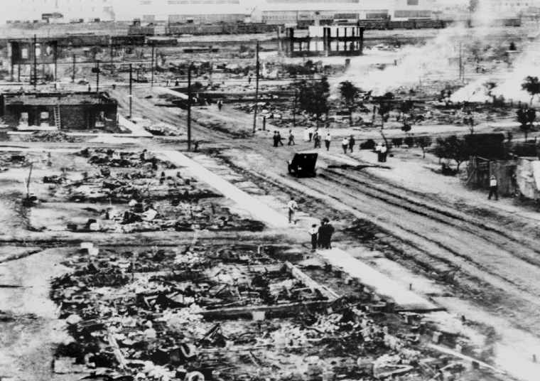 A white mob attacked the prosperous black business district of Greenwood in 1921, leaving hundreds of people dead, and their homes and businesses burned to the ground. ( and unknown/Greenwood Cultural Center, Tulsa, OK.)