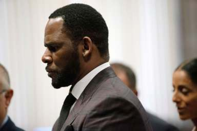 R. Kelly charged with bribing Illinois state official in order to marry underage Aaliyah
