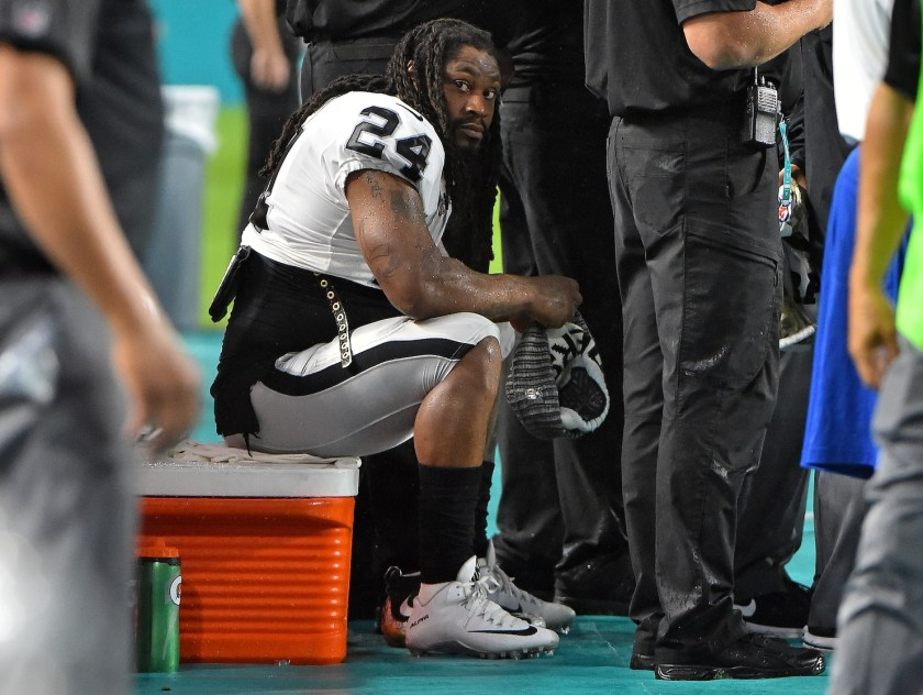 Image result for marshawn lynch kneels