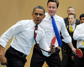 (President Barack Obama and Prime Minister David Cameron play table tennis at Globe Academy. / AP)