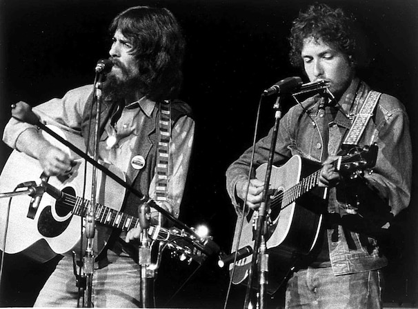 George Harrison, left, and Bob Dylan perform together onstage for the first time in history in the Concert for Bangladesh. (Apple/20th Century Fox)