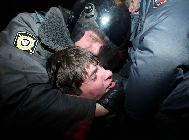 "Police detain an activist during a protest rally by opposition group ""Another Russia"" in central Moscow Sunday. (Reuters)"