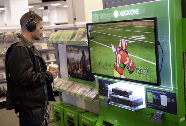 A customer looks at a display of Microsoft's next-generation console, the Xbox One at Best Buy in Union Square in New York  November 19, 2013. The Xbox One will be launched on November 22, 2013 .AFP PHOTO / TIMOTHY CLARYTIMOTHY CLARY/AFP/Getty Images