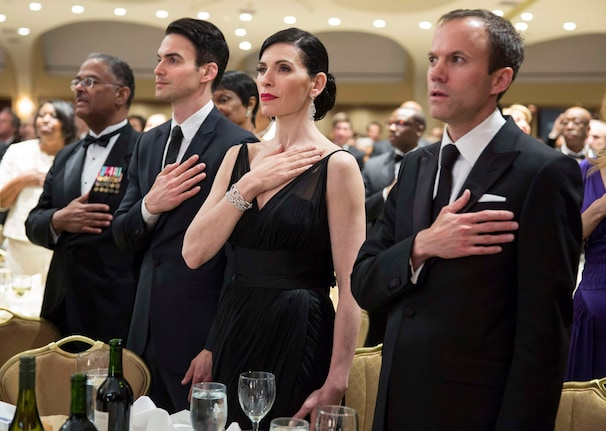 Actress Julianna Margulies stands with others at her table during the Pledge of Allegiance at the White House Correspondents' Association dinner in Washington. (Joshua Roberts/ Reuters)