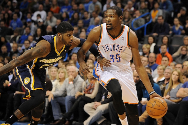 Dec 8, 2013; Oklahoma City, OK, USA; Oklahoma City Thunder small forward Kevin Durant (35) handles the ball against Indiana Pacers small forward Paul George (24) during the first quarter at Chesapeake Energy Arena. Mandatory Credit: Mark D. Smith-USA TODAY Sports