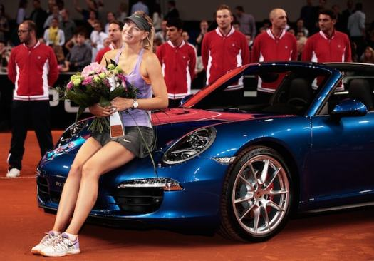 STUTTGART, GERMANY - APRIL 27:  Maria Sharapova of Russia celebrates victory in the final against Ana Ivanovic of Serbia on day seven of the Porsche Tennis Grand Prix 2014 at Porsche-Arena on April 27, 2014 in Stuttgart, Germany.  (Photo by Adam Pretty/Bongarts/Getty Images)