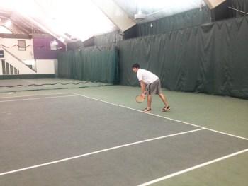 Lucas Valota playing tennis