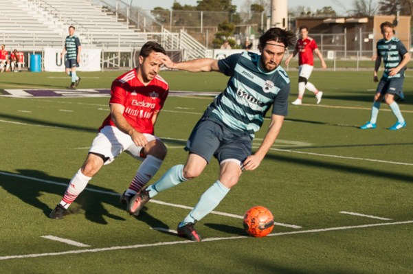 Ann Arbor midfielder Kevin Robinson keeps possession away from a San Marino player at the AFC Ann Arbor season opener on Friday, May 1 at Hollway Field. EJ Stout   Washtenaw Voice