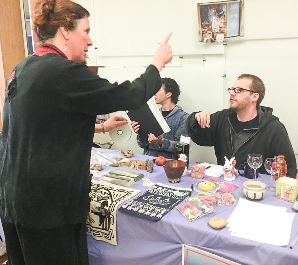 Elizabeth Thoburn gives instructions to Arts Club fundraiser volunteer