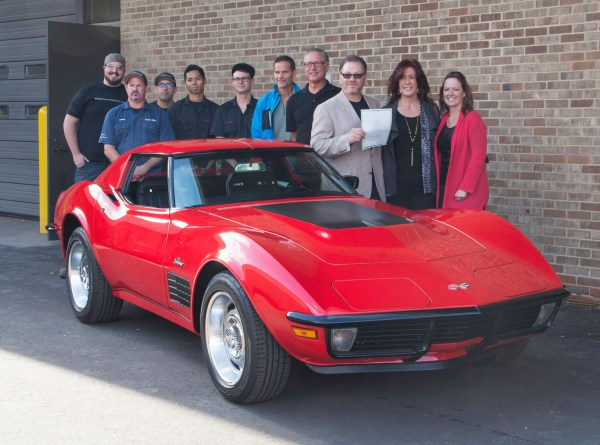 WCC students stand next a red corvette