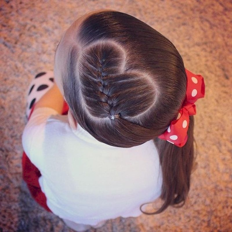 Braided hair style with heart shaped side with red ribbon