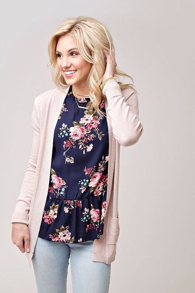 Spring outfit with knit sweater and a floral blouse