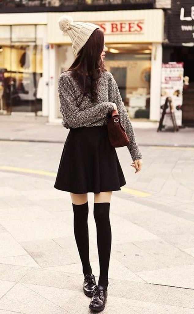 Spring outfit with white red sweater and little flared black skirt