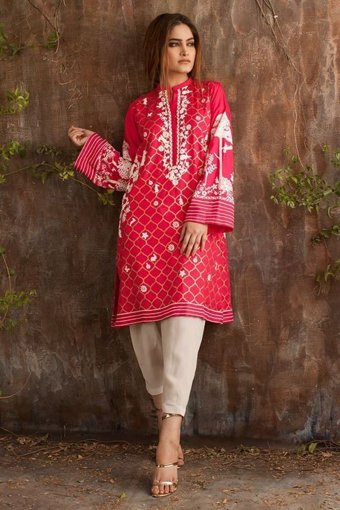 Red embroidered dresses with grey over trousers