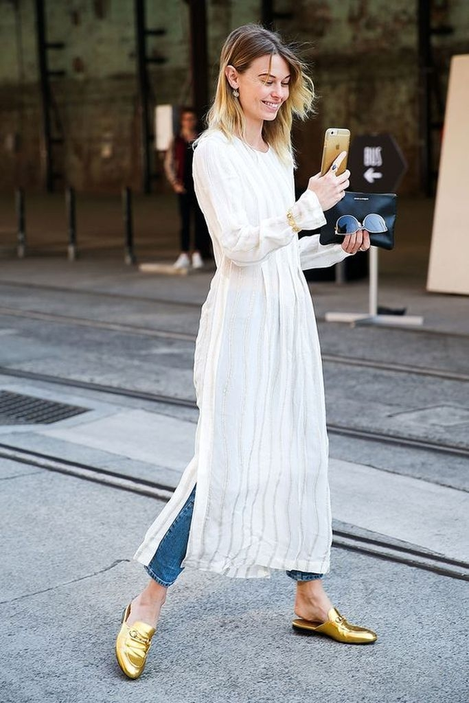 White maxi dresses with blue jeans and gold statement loafers
