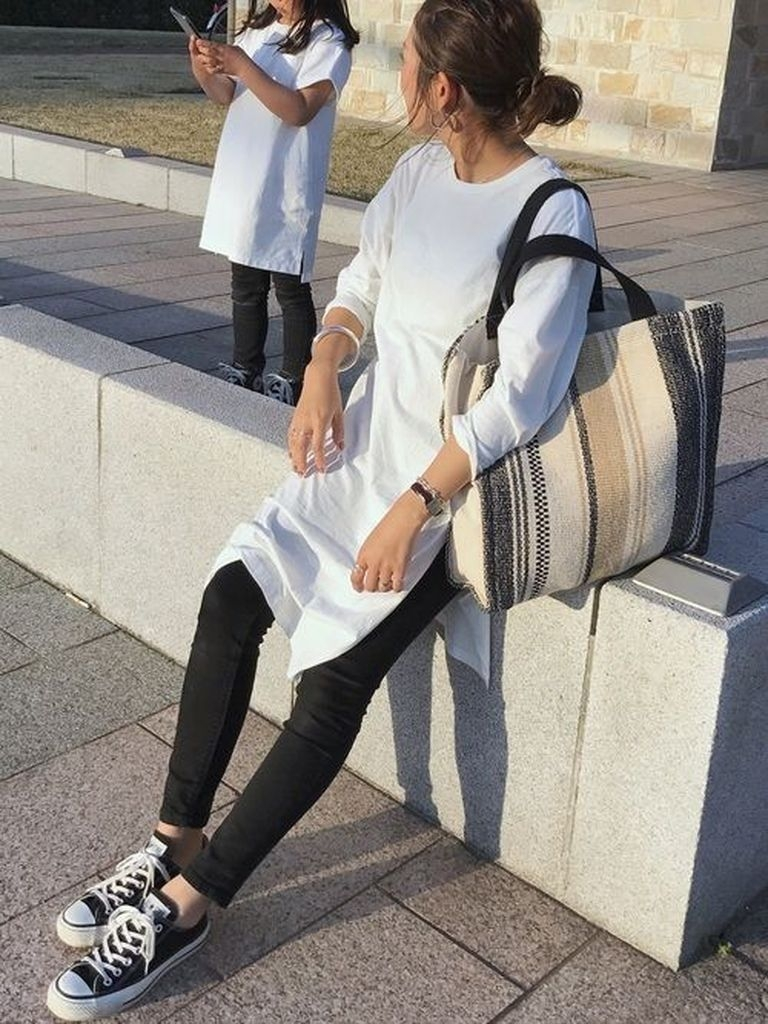 White medium dresses with sneakers and black jeans