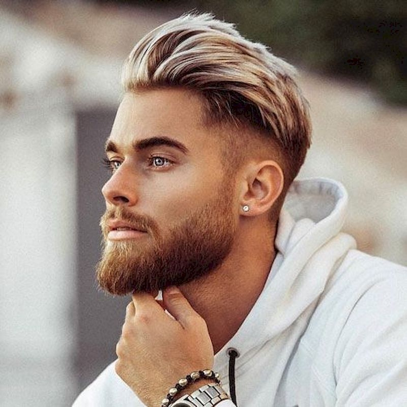Haircuts for men with thick brushed back hair on top and full beard
