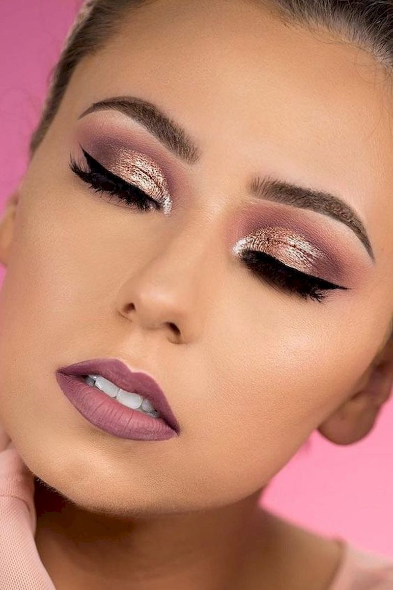 Rose gold makeup with purple lipstick