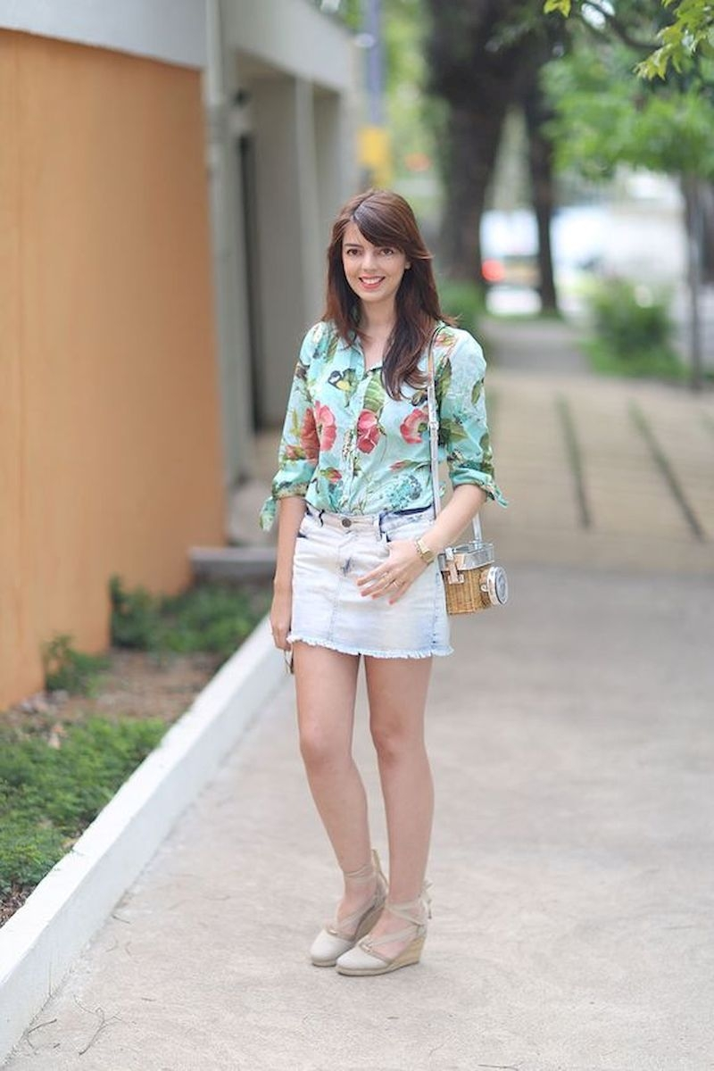 Spring outfit inspiration with floral blouse and short denim skirt