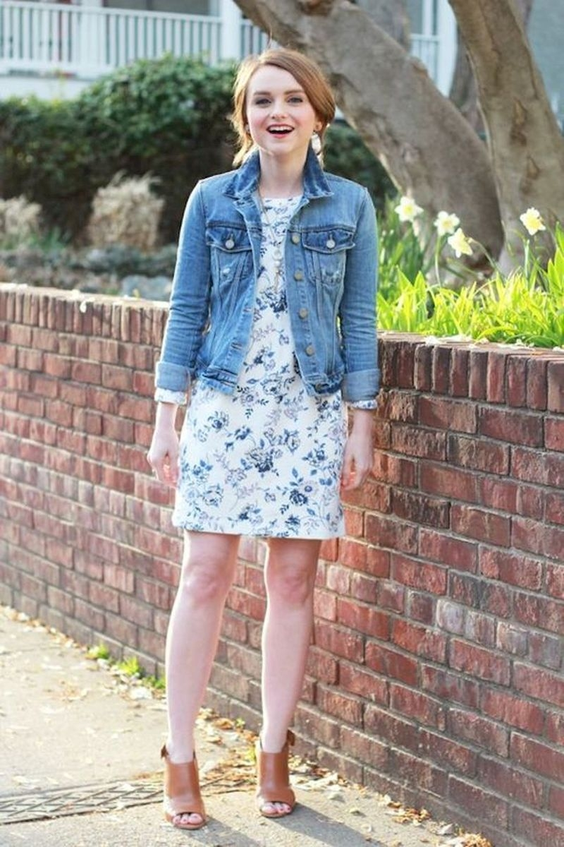 Spring outfit inspiration with white floral dress and denim jacket