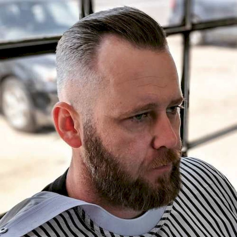 Hairstyles for bald men with short top hairs combed back and thick beards