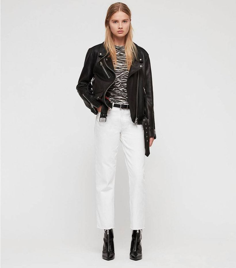 Black jacket with black white pattern t-shirt, white pants and black boots