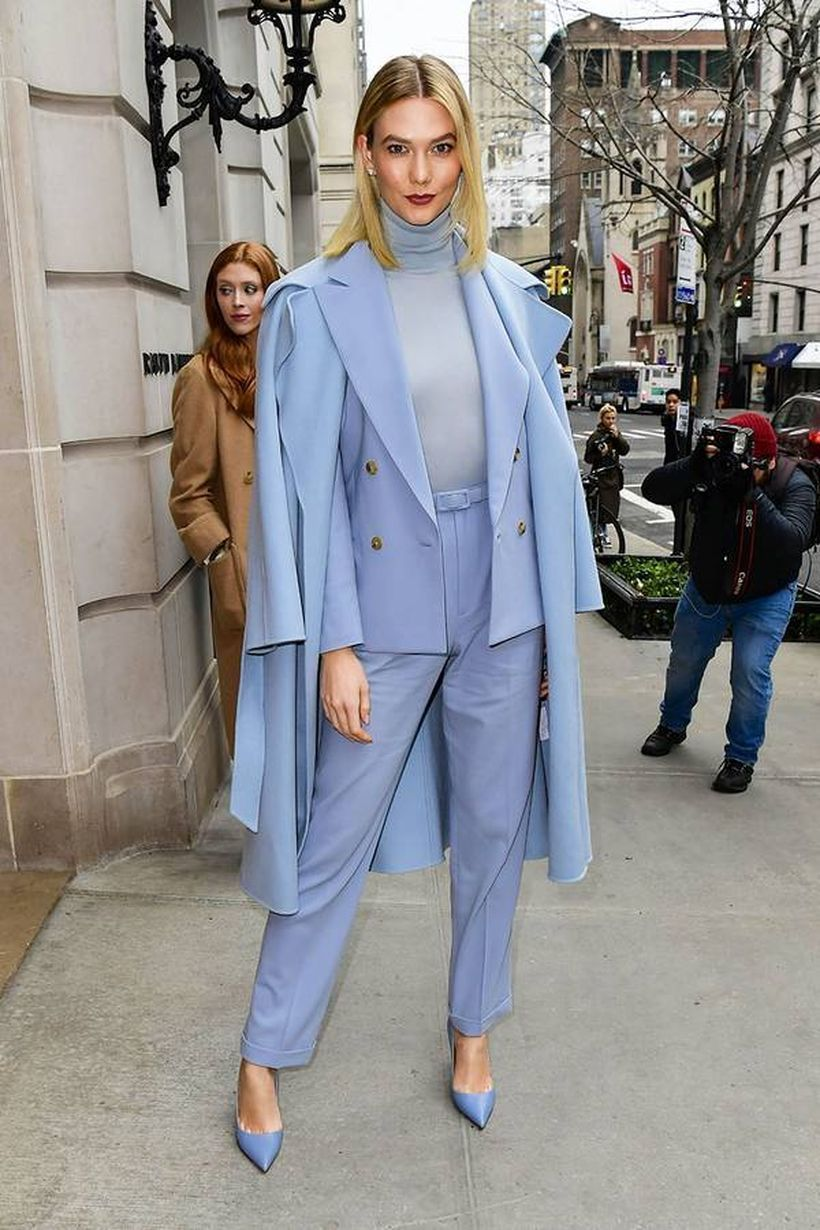 Long blue outer with blue blazer, gray t-shirt, blue pants and blue high heels