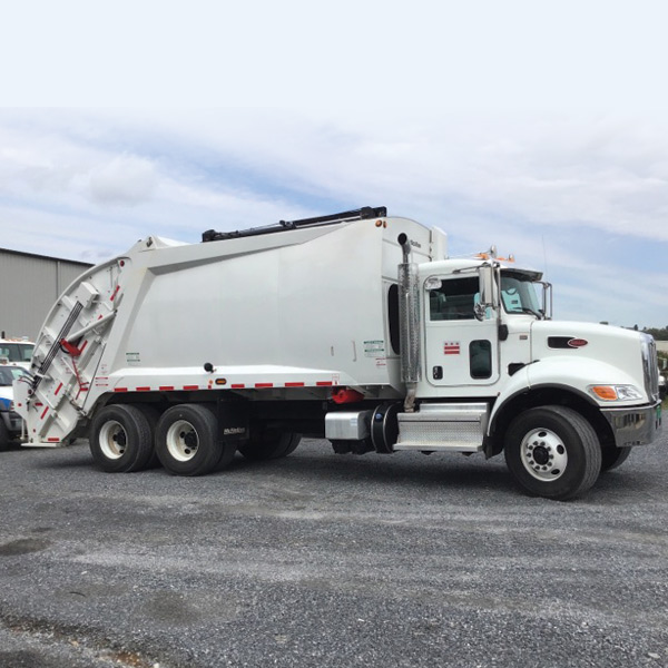 Used Peterbilt 348 / McNeilus Rear Loader truck