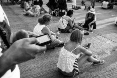 People busy with their smartphones in New York city