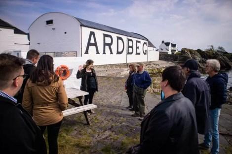 A group at a distillery tour at Ardbeg Distillery on Islay.